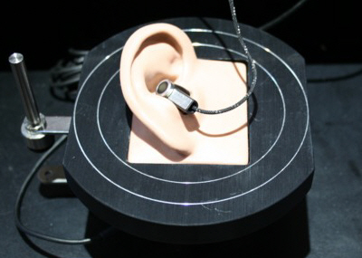 An earbud in an artificial ear